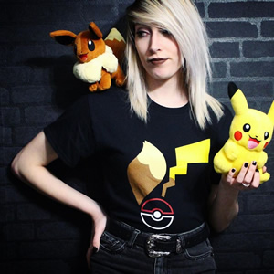 Electric mouse and adorable fox, it's time to battle! @pkmn_home is ready to roll in her Tales of Kanto tee!